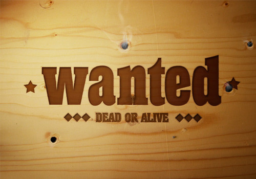 Wanted Sign Into A Piece of Wood